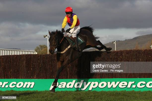 Jockey Joe Tizzard on Hey Big Spender during the Rewards4Racing Handicap Chase