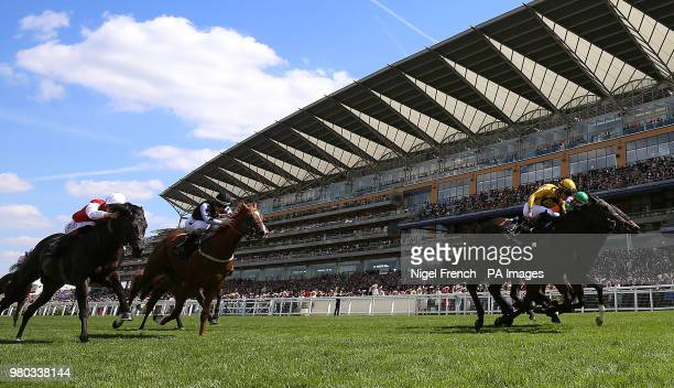 Jockey Joel Rosario on board Shang Shang Shang leads the race at The Norfolk Stakes during day three of Royal Ascot at Ascot Racecourse.