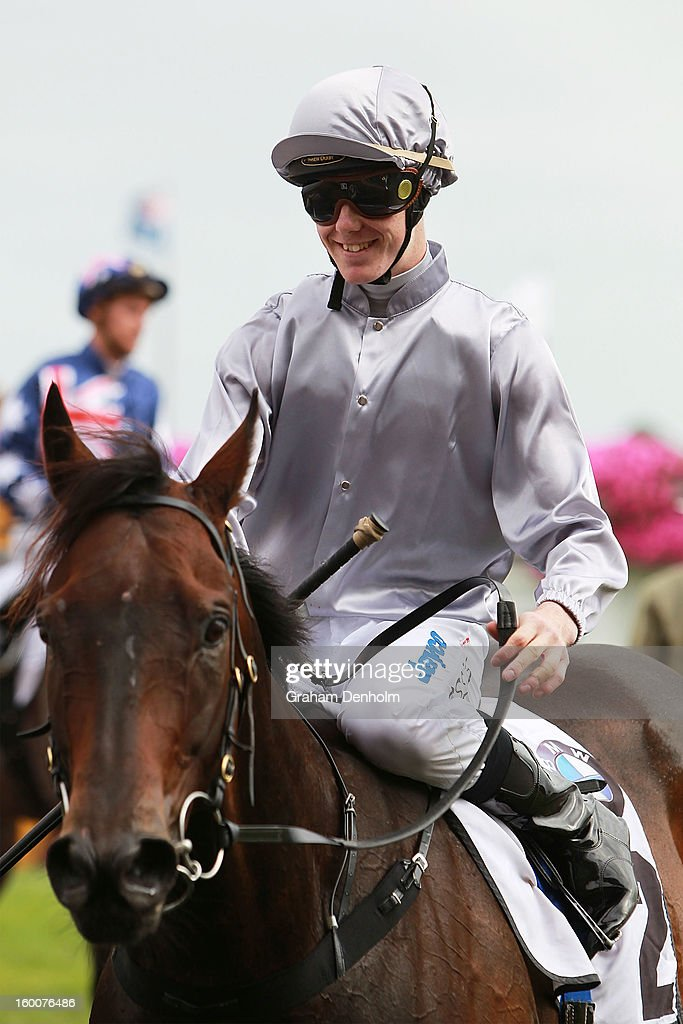 Jockey John Kissick smiles after riding Rescue Mission to win race seven the BMW Handicap during Australia Day Races at Caulfield Racecourse on January 26, 2013 in Melbourne, Australia.