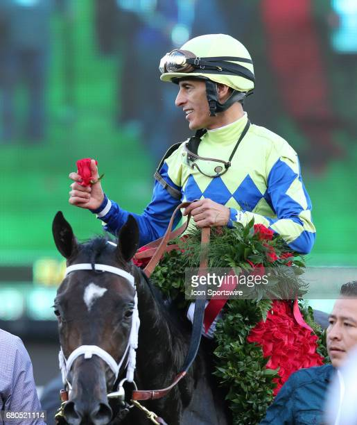 Jockey John Valazequez gives out roses after riding Always Dreaming to the win during the 143rd Kentucky Derby at Churchill Downs in Louisville...
