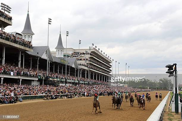 Jockey John Valazquez, riding Animal Kingdom, leads the field across the finish line to win the 137th Kentucky Derby at Churchill Downs on May 7,...