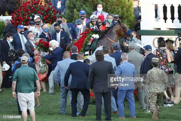 Jockey John Velazquez, attempts to control Authentic, after he was startled and knocked trainer Bob Baffert in the winner's circle after winning the...