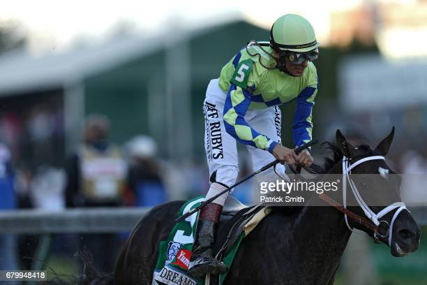 Jockey John Velazquez celebrates atop Always Dreaming as they cross the finish line after winning the 143rd running of the Kentucky Derby at...