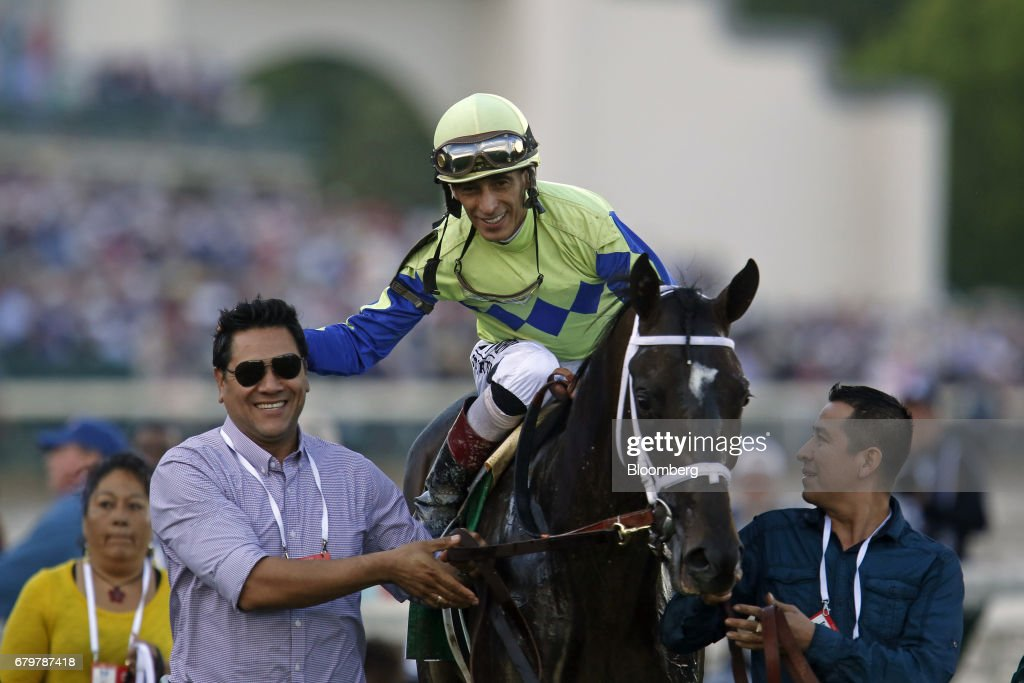 Jockey John Velazquez, center, celebrates while riding Always Dreaming after winning the 143rd running of the Kentucky Derby at Churchill Downs in Louisville, Kentucky, U.S., on Saturday, May 6, 2017. The 143rd running of the Kentucky Derby will feature a field of twenty horses with the winner receiving a gold trophy plus an estimated $1.24 million payday. Photographer: Luke Sharrett/Bloomberg via Getty Images