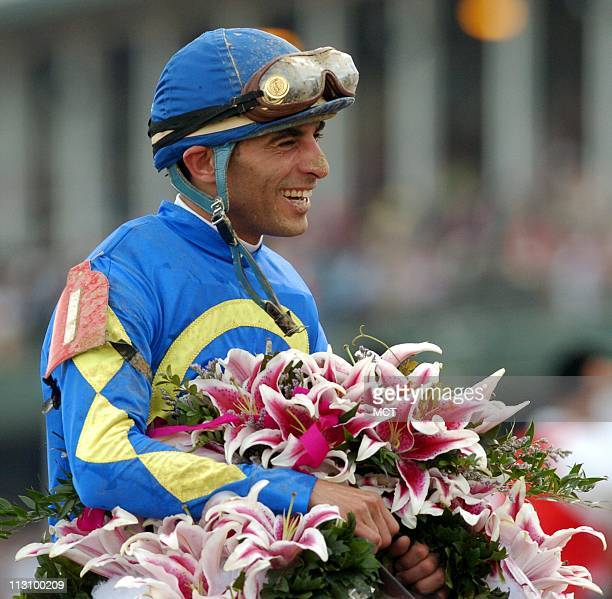 LOUISVILLE KY Jockey John Velazquez holds a blanket of lillies as he sits atop Ashado after riding the horse to victory in the 130th Running of the...