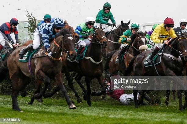 Jockey Jonathan Moore in amongst it after falling from Newsworthy at the 'Chair' in The Randox Health Topham Handicap Steeple Chase at Aintree...