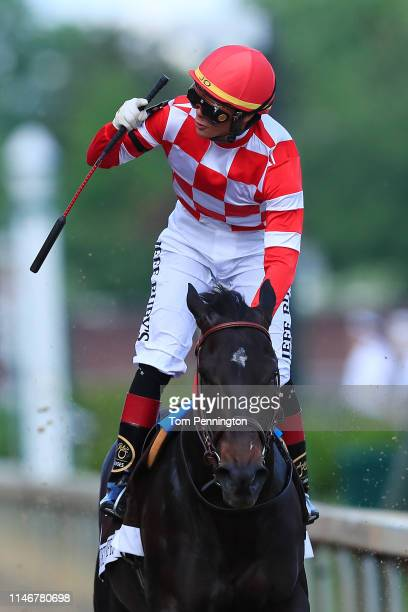 Jockey Jose Ortiz celebrates aboard Serengeti Empress after crossing the finish line to win the 145th running of the Kentucky Oaks at Churchill Downs...