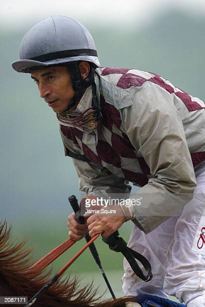 Jockey Jose Santos aboard Funny Cide trots back up the track after finishing third in the 135th Belmont Stakes on June 7 2003 at Belmont Park in...