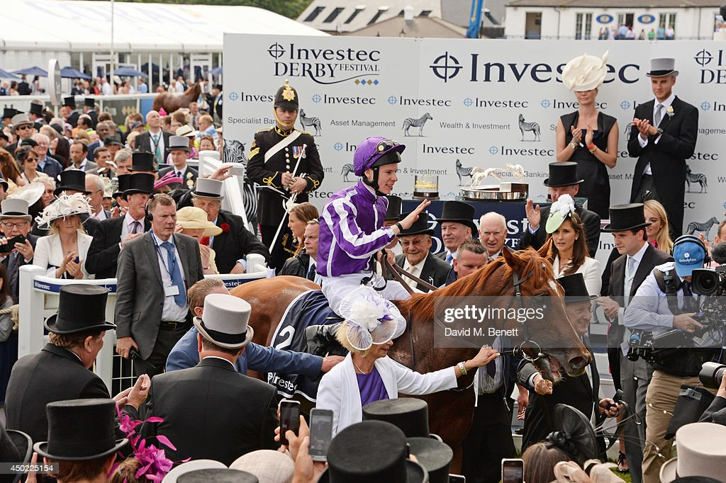 Jockey Joseph O'Brien rides winning horse Australia into the Winner's Enclosure after winning The Investec Derby duing Derby Day at the Investec Derby Festival at Epsom Downs Racecourse on June 6, 2014 in Epsom, England.