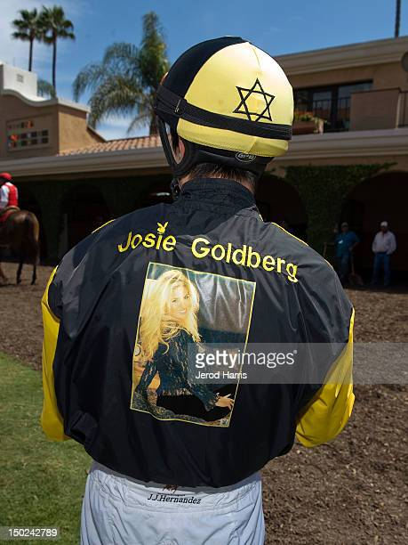 Jockey Juan Hernandez wears a custom silk embroidered with a portrait of Playboy TV personality Josie Goldberg prior to racing Only Josie Knows at...