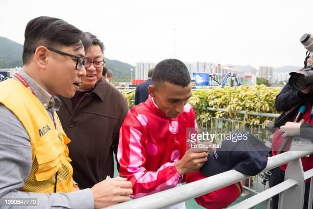 Jockey Karis Teetan gives his autograph to racing fans during the LONGINES Hong Kong International Races Day at Sha Tin Racecourse on December 9 2018...