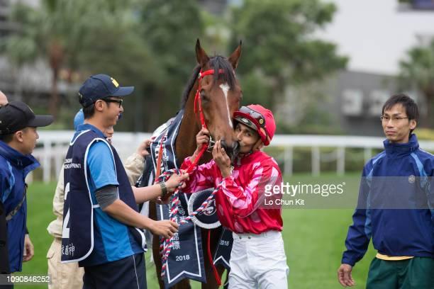 Jockey Karis Teetan kisses Mr Stunning after winning Race 5 Longines Hong Kong Sprint at Sha Tin racecourse during the LONGINES Hong Kong...