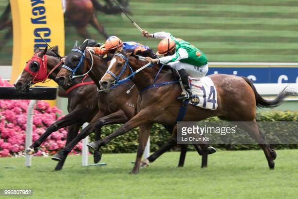 Jockey Karis Teetan riding Navel Orange wins Race 2 Harlech Handicap at Sha Tin racecourse on April 7 2015 in Hong Kong