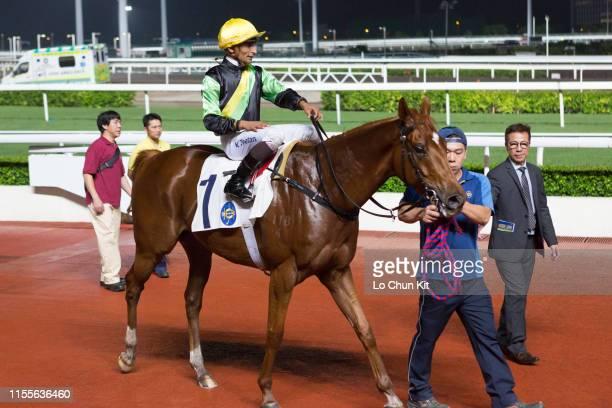 Jockey Karis Teetan riding Ugly Warrior wins Race 7 Butterfly Bay Handicap at Sha Tin Racecourse on June 12 2019 in Hong Kong