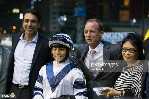 Jockey Keith Yeung Minglun trainer Richard Gibson and owners celebrate after Starlot winning the Race 3 Plover Cove Handicap at Happy Valley...