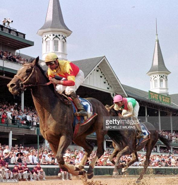 Jockey Kent Desormeaux crosses the finish line aboard Fusaichi Pegasus to win the 126th Kentucky Derby ahead of Aptitude and jockey Alex O Solis 06...