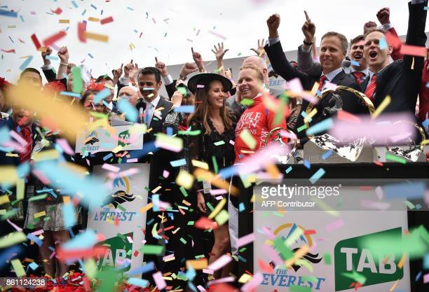 Jockey Kerrin McEvoy and his wife Cathy and brothers and part owners of winning horse Redzel Chris Ward and Michael Ward celebrate after they won the...
