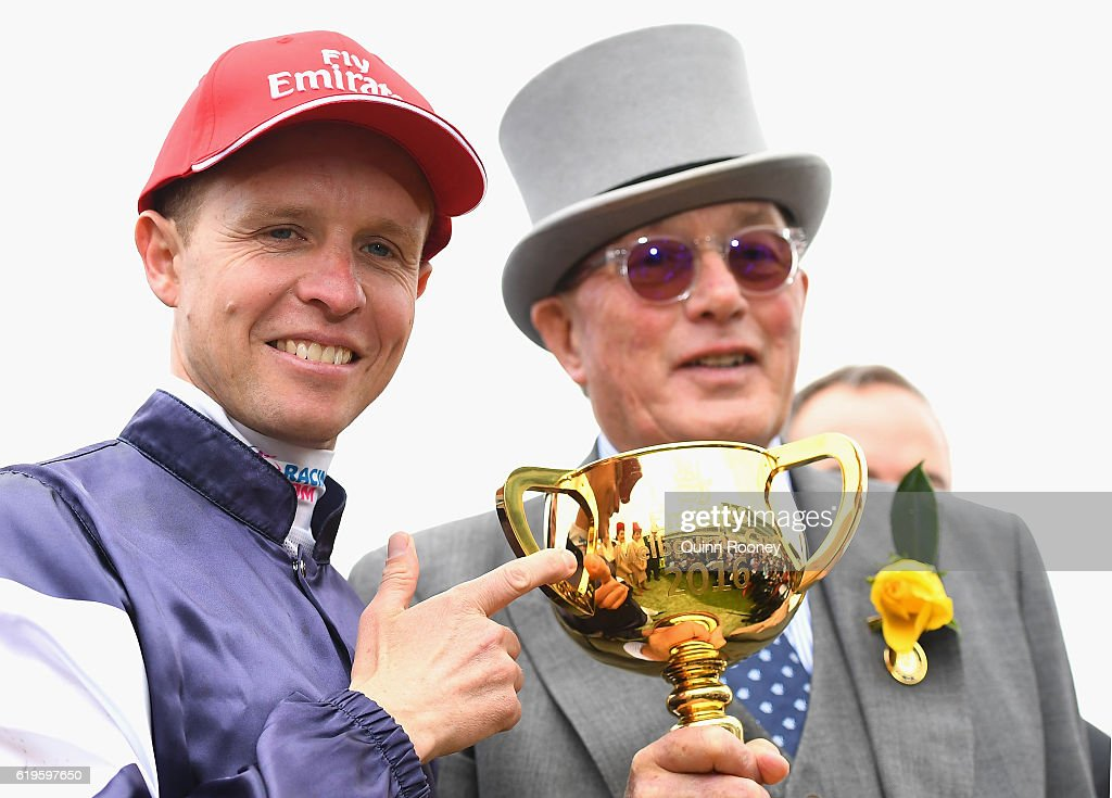 Jockey Kerrin McEvoy and owner Lloyd Williams pose with the Melbourne Cup after their horse Almandin won race 7, the Emirates Melbourne Cup on Melbourne Cup Day at Flemington Racecourse on November 1, 2016 in Melbourne, Australia.
