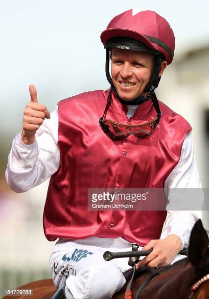 Jockey Kerrin McEvoy celebrates after riding Guelph to win race six the Schweppes Thousand Guineas during Thousand Guineas Day at Caulfield...