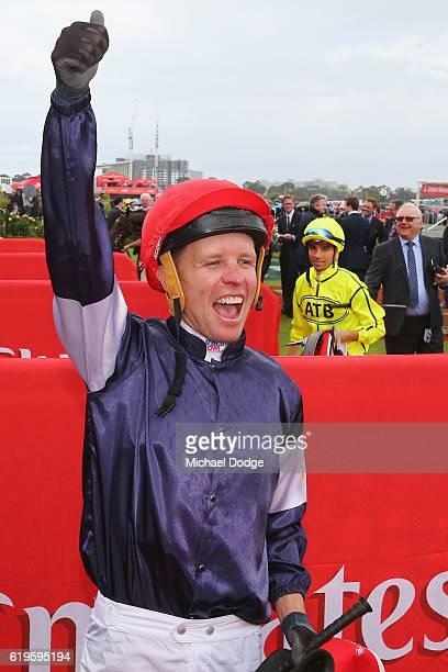 Jockey Kerrin McEvoy celebrates his win on Almandin ahead of Jockey Joao Moreira on Heartbreak City in race 7 the Emirates Melbourne Cup on Melbourne...