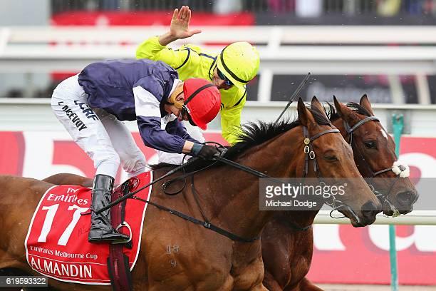 Jockey Kerrin McEvoy riding Almandin wins ahead of Jockey Joao Moreira on Heartbreak City who pats him on the back in race 7 the Emirates Melbourne...