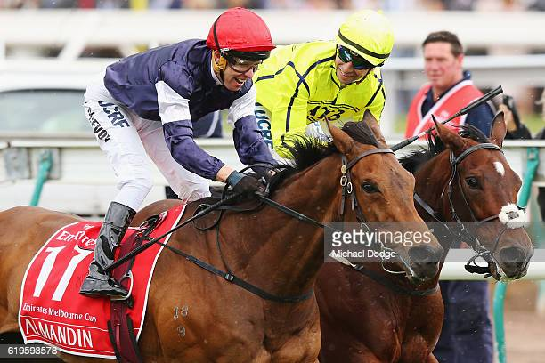 Jockey Kerrin McEvoy riding Almandin wins ahead of Jockey Joao Moreira on Heartbreak City in race 7 the Emirates Melbourne Cup on Melbourne Cup Day...