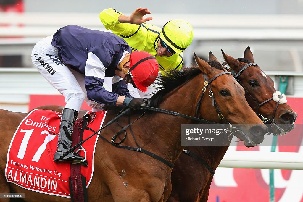 Jockey Kerrin McEvoy riding Almandin wins ahead of Jockey Joao Moreira on Heartbreak City who pats him on the back in race 7 the Emirates Melbourne Cup on Melbourne Cup Day at Flemington Racecourse on November 1, 2016 in Melbourne, Australia.