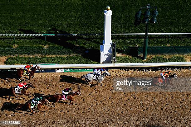 Jockey Kerwin D Clark celebrates atop of Lovely Maria after crossing the finish line to win the 141st running of the Kentucky Oaks at Churchill Downs...