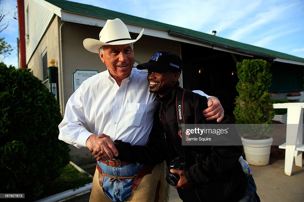 Jockey Kevin Krigger (R) shakes hands with trainer D. Wayne Lucas in front of his barn following a morning training session in preparation for the 2013 Kentucky Derby at Churchill Downs on May 2, 2013 in Louisville, Kentucky.