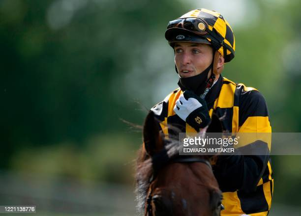 Jockey Kevin Stott celebrates after riding Hello Youmzain to win The Diamond Jubilee Stakes on day five of the Royal Ascot horse racing meet, in...