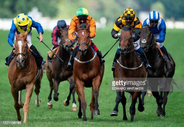 Jockey Kevin Stott rides Hello Youmzain to win The Diamond Jubilee Stakes on day five of the Royal Ascot horse racing meet, in Ascot, west of London,...