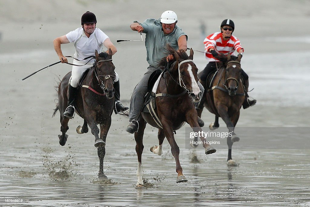 Jockey Kingi Winiata leads out on his way to winning the Stewards Handicap during the Castlepoint Beach Races at Castlepoint Beach on March 2, 2013 in Masterton, New Zealand.
