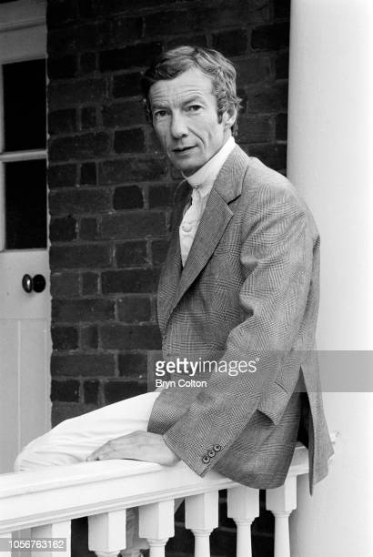 Jockey Lester Piggott poses for a photograph in the winner's enclosure at Sandown Park racecourse before riding at the course in Esher Surrey UK on...