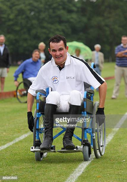 Jockey Liam Treadwell takes part in a wheel chair race at the Rundle Cup at Tidworth Polo Club on July 11 2009 in Wiltshire England