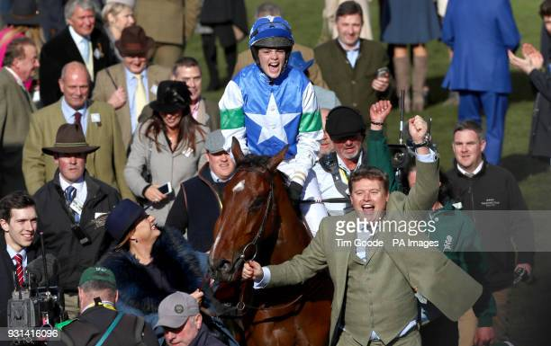 Jockey Lizzie Kelly celebrates winning the Ultima Handicap Steeple Chase with horse Coo Star Sivola during Champion Day of the 2018 Cheltenham...