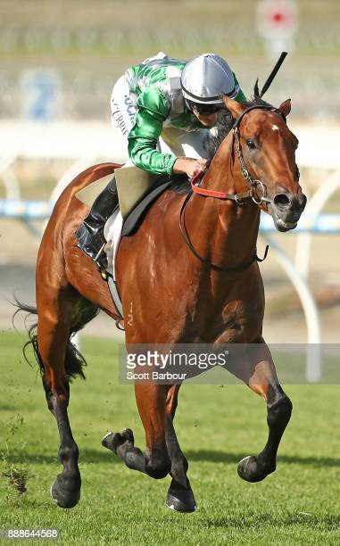 Jockey Luke Currie rides Amadeus to win race 8 the Racingcom VOBIS Gold Bullion during Melbourne Racing at Racingcom Park on December 9 2017 in...