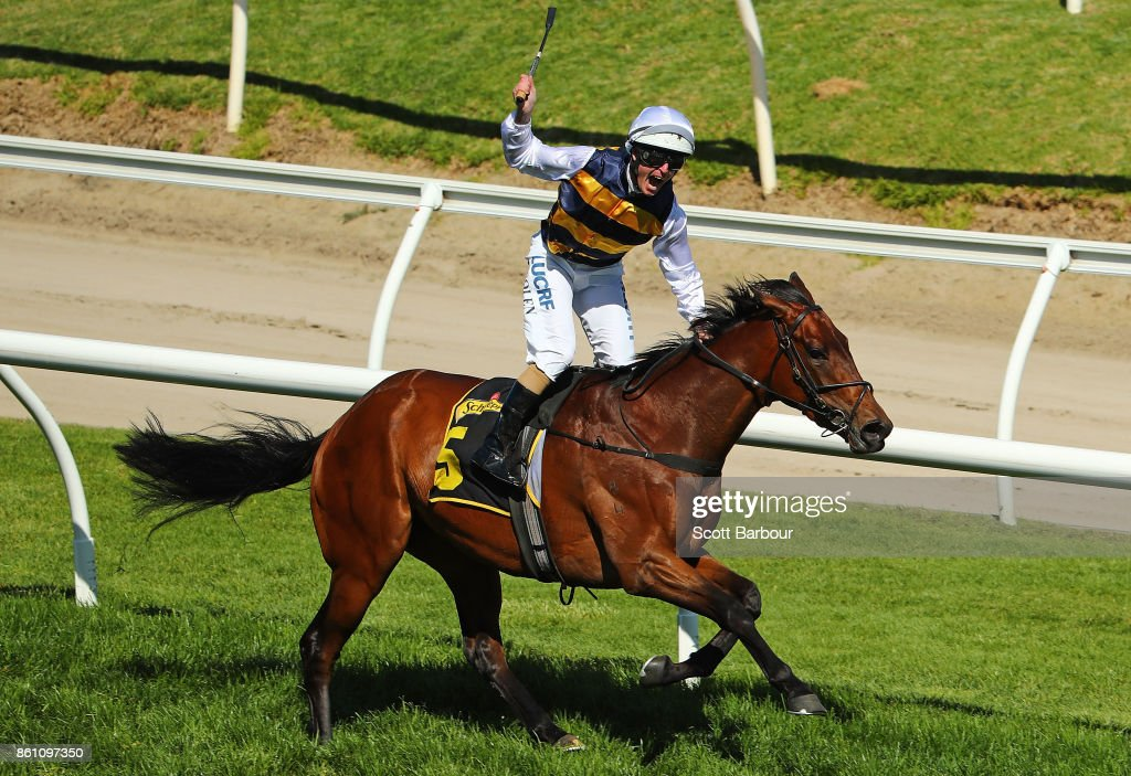 Jockey Luke Nolen riding Aloisia celebrates winning race 6 the Schweppes Thousand Guineas during Melbourne Racing on Caulfield Guineas Day at Caulfield Racecourse on October 14, 2017 in Melbourne, Australia.