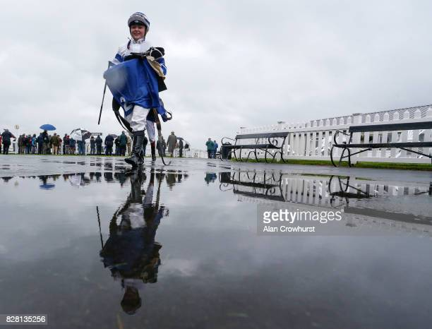 Jockey Lulu Stanford returns to the weighing room after riding the first winner at Bath racecourse on August 9 2017 in Bath England