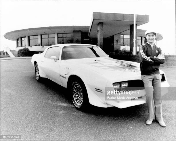 Jockey Malcolm Johnston with his new Pontiac with an Eagle painted on the Bonnet Outside the lakes golf Club where he had just finished a round April...