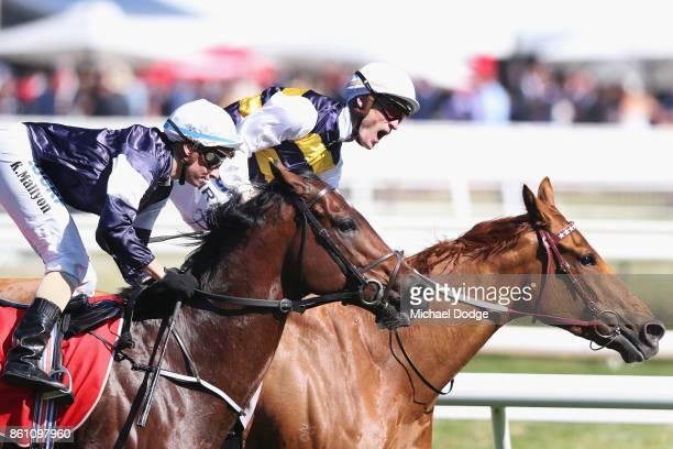 Jockey Mark Zahra celebrates winning on Gailo Chop from Katelyn Maylon on Johannes Vermeer during Melbourne Racing on Caulfield Guineas Day at...