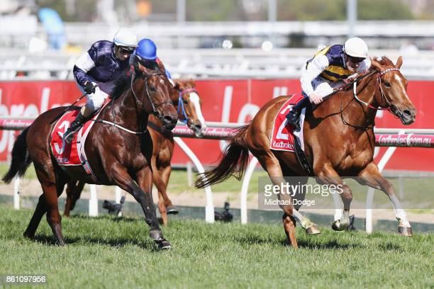 Jockey Mark Zahra riding Gailo Chop wins from Katelyn Maylon on Johannes Vermeer during Melbourne Racing on Caulfield Guineas Day at Caulfield...