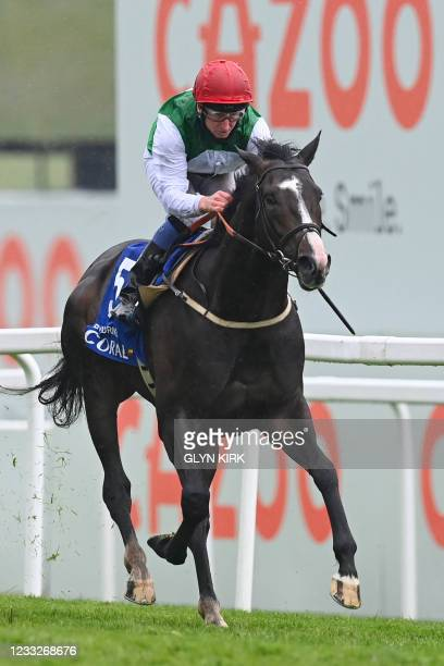Jockey Martin Dwyer on Pyledriver win the Coronation Cup on the first day of the Epsom Derby Festival horse racing event in Surrey, southern England...