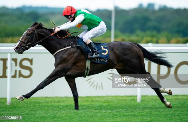 Jockey Martin Dwyer rides Pyledriver to victory in the King Edward VII Stakes on day one of the Royal Ascot horse racing meet in Ascot west of London...