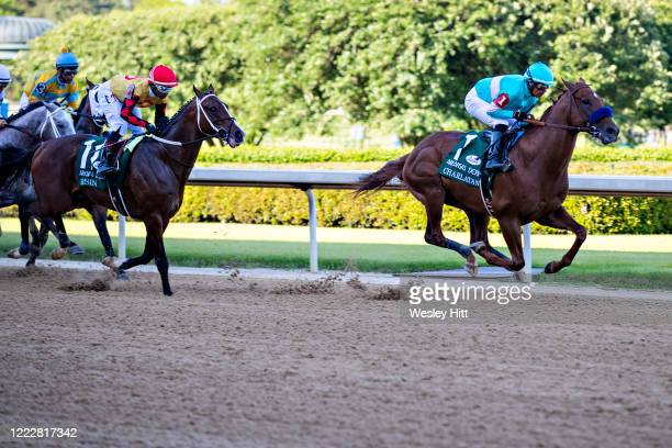 Jockey Martin Garcia rides Charlatan to the lead during the 84th running of The Arkansas Derby Grade 1 at Oaklawn Racing Casino Resort on Derby Day...
