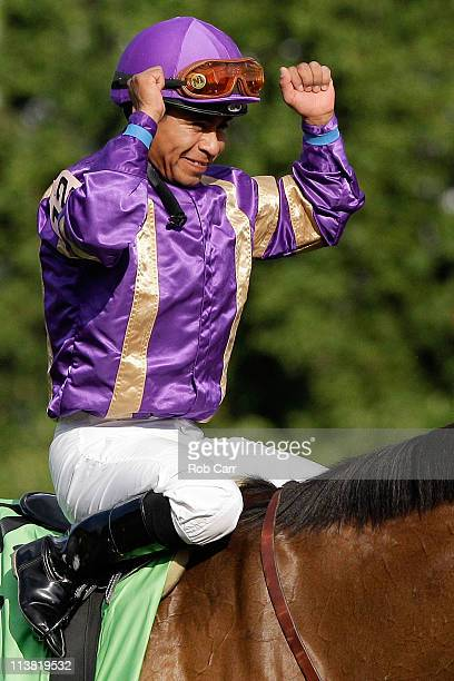 Jockey Martin Garcia riding Plum Pretty celebrates in the winners circle after they won the 137th Kentucky Oaks at Churchill Downs on May 6 2011 in...