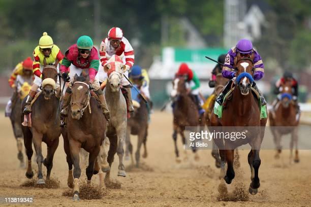 Jockey Martin Garcia riding Plum Pretty edges out Jockey Rosie Napravnik riding St John's River to win the 137th Kentucky Oaks at Churchill Downs on...