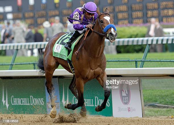 Jockey Martin Garcia riding Plum Pretty heads towards the finish line to win the 137th Kentucky Oaks at Churchill Downs on May 6 2011 in Louisville...
