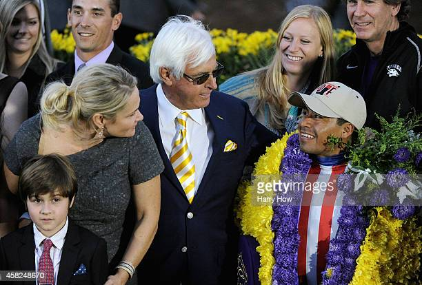 Jockey Martin Garcia trainer Bob Baffert and Jill Baffert celebrate in the winner's circle after Bayern came in first place to win the 2014 Breeders'...