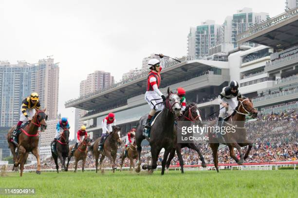 Jockey Masami Matsuoka riding Japanese horse Win Bright wins Race 8 The FWD Queen Elizabeth II Cup at Sha Tin Racecourse on April 28, 2019 in Hong...