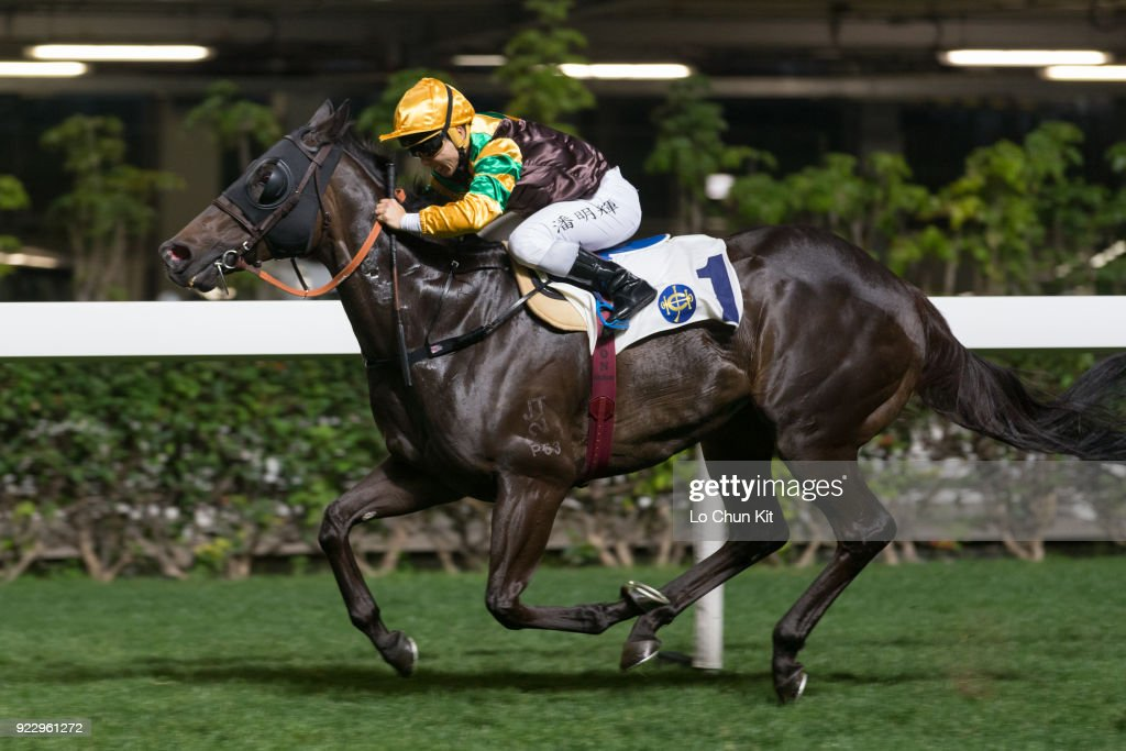 Jockey Matthew Poon Ming-fai riding Winfull Patrol wins the Race 1 Yuk Sau Handicap at Happy Valley Racecourse on February 21, 2018 in Hong Kong, Hong Kong.